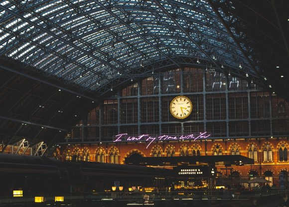 View of the metal work roof of St Pancras train station at night